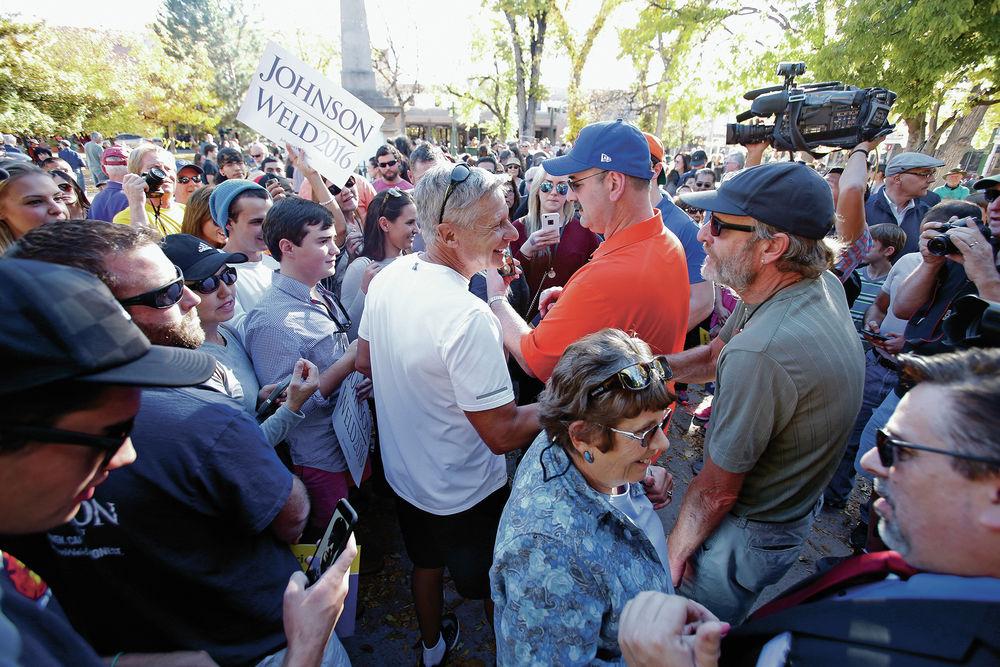 After bike trek, Johnson speaks at rally on Plaza