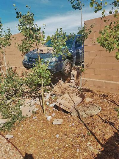 Parking Division car crashes through residential wall
