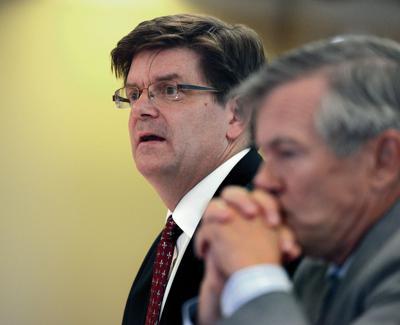 Judge finds cash-strapped chief public defender in contempt