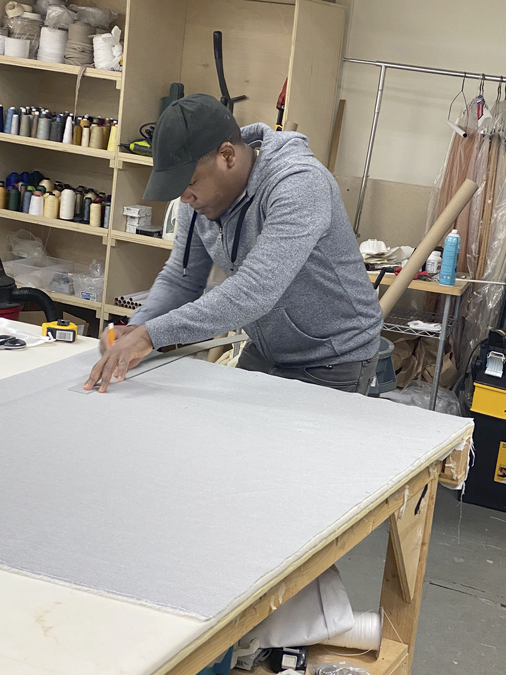 COVID mask makers cutting fabric 3.jpg