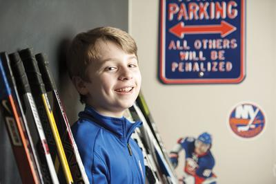 Collecting hockey sticks to benefit education