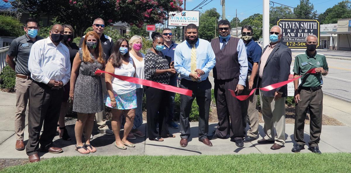 Steven Smith Injury Law Firm holds ribbon cutting with chamber