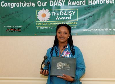 McLeod share-the-care nurse receives DAISY Award | Business