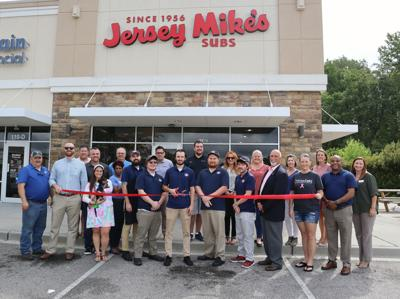 A ribbon cutting celebrates the opening of Jersey Mike's in Florence