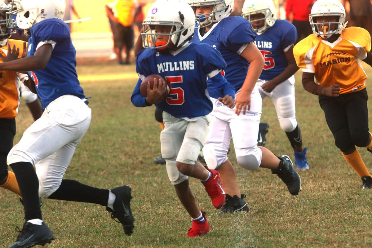 20191016_mse_sports_Marion hosts youth football game action against Mullins_p1