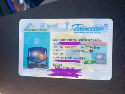 A  woman is stunned when her new driver's license came back with a picture of an empty chair
