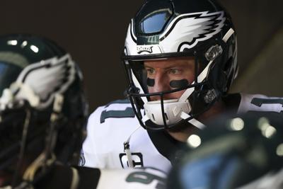 Eagles quarterback Carson Wentz stands in the tunnel before taking on the Arizona Cardinals at State Farm Stadium in Glendale, Ariz. on Sunday, Dec. 20, 2020.