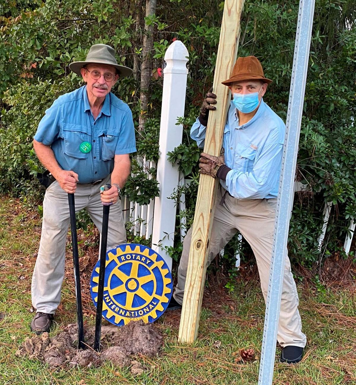 Tommy Taylor and Rick Favaloro of the Florence Rotary Club dig a post hole Tuesday on the Florence Rotary Beauty Trail.