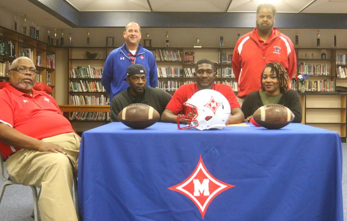 Mullins' Phillips signs to play football at Limestone College
