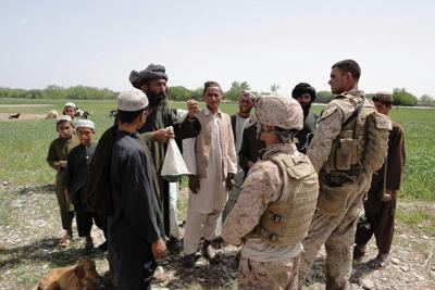 U.S. soldier conversing with citizens of Afghanistan