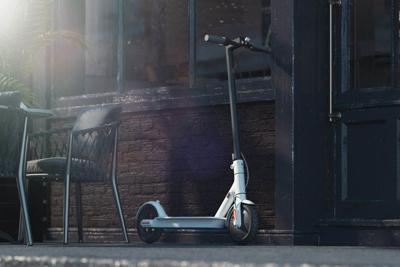 Electric scooter on cityscape background.