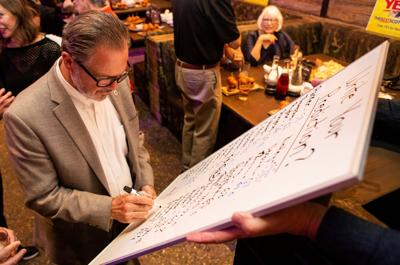 Scottsdale Mayor  Jim Lane fills out his prediction for the margin of victory for Scottsdale's three bond questions at an Election Night event hosted by the pro-bond For the Best Scottsdale political action committee.