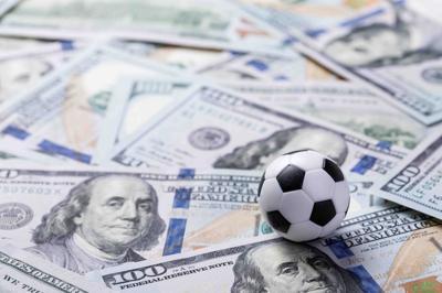 Soccer ball on dollar banknotes