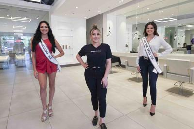 Glow Blow Bar owner Lynette Louissia, flanked by Miss Arizona USA Yesenia Vidales, left, and Miss Arizona Teen USA Molly Schwanz