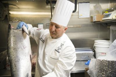 Ocean 44 chef prepares salmon after catching it ocean to table farm