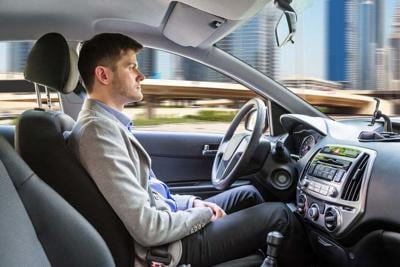 Man Sitting Autonomous Car