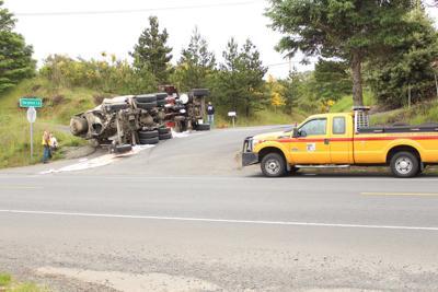 Concrete truck overturns