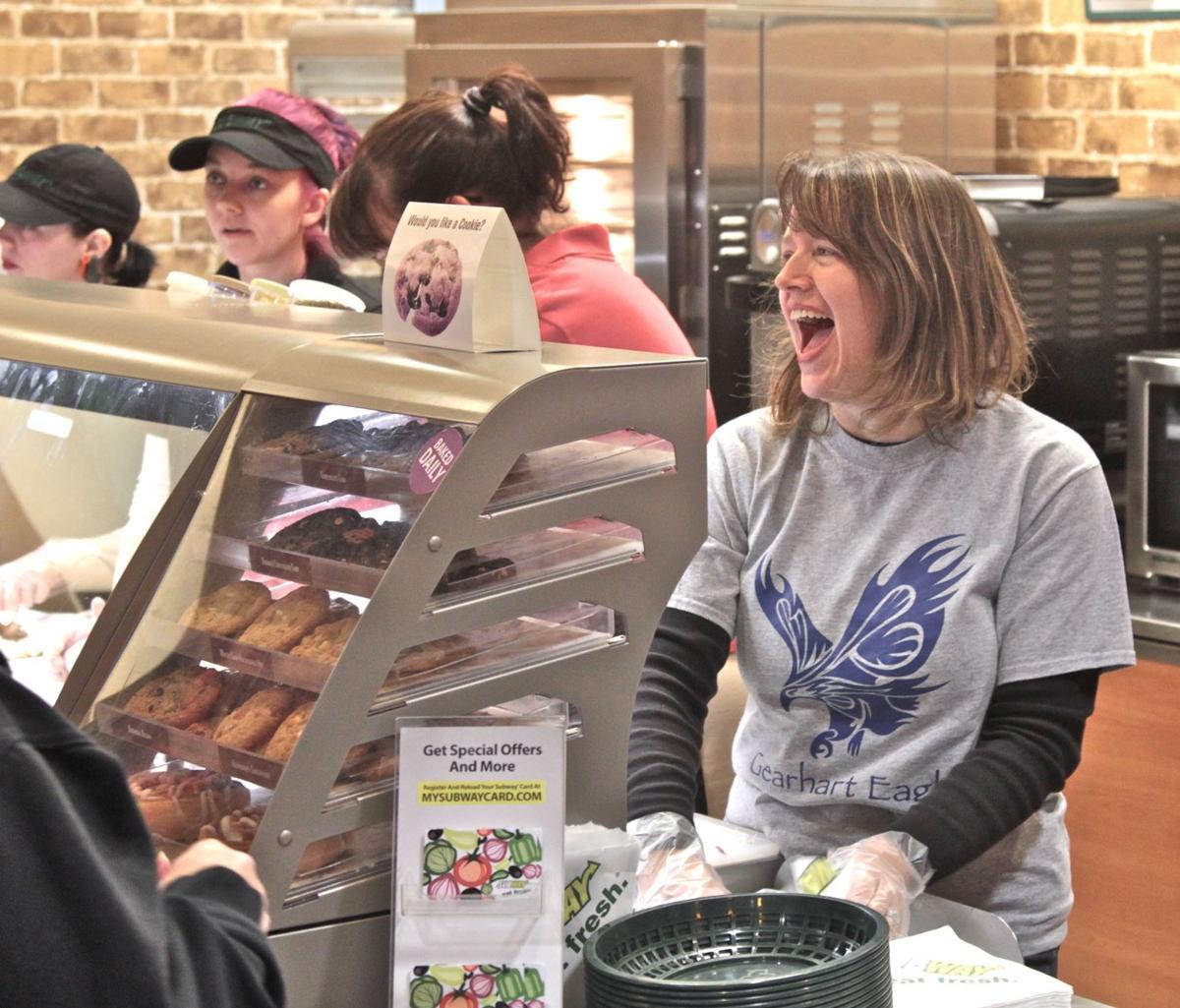 Volunteers sandwich their time between school and snacks