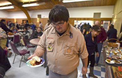 Volunteers serve Thanksgiving food in Seaside