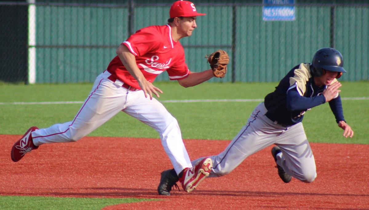 Seaside's Duncan Thompson makes the tag
