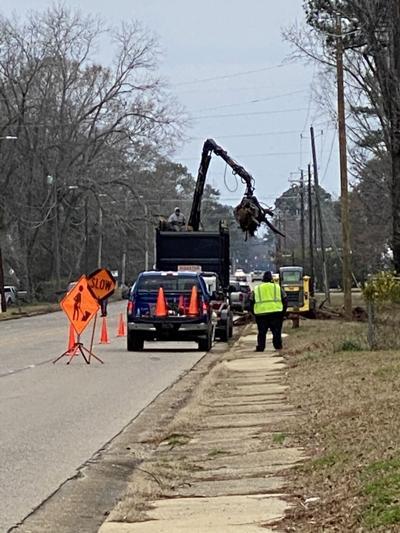 Contractors pick up hurricane debris on Dallas Avenue