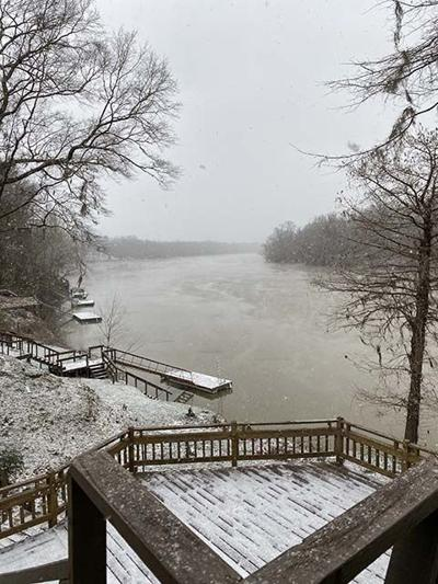 Snow fall Tuesday on the river