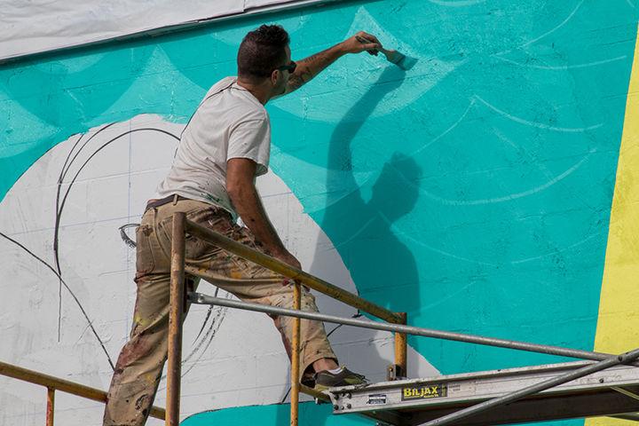 Roger Peet Painting Mural on Temple Studios