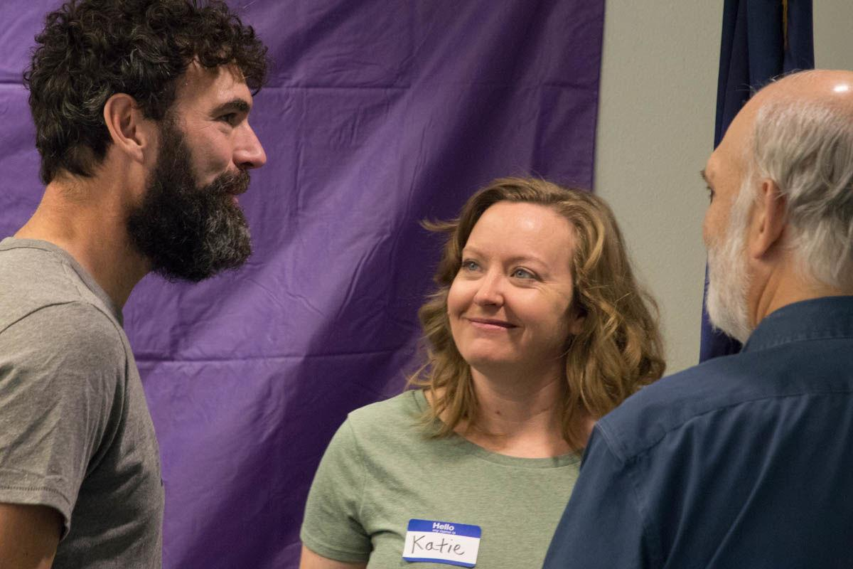 Mike Stewart, Katie Cornwell and Craig Ambrosiani converse during the third annual Seward Strong planning day on Thursday morning.