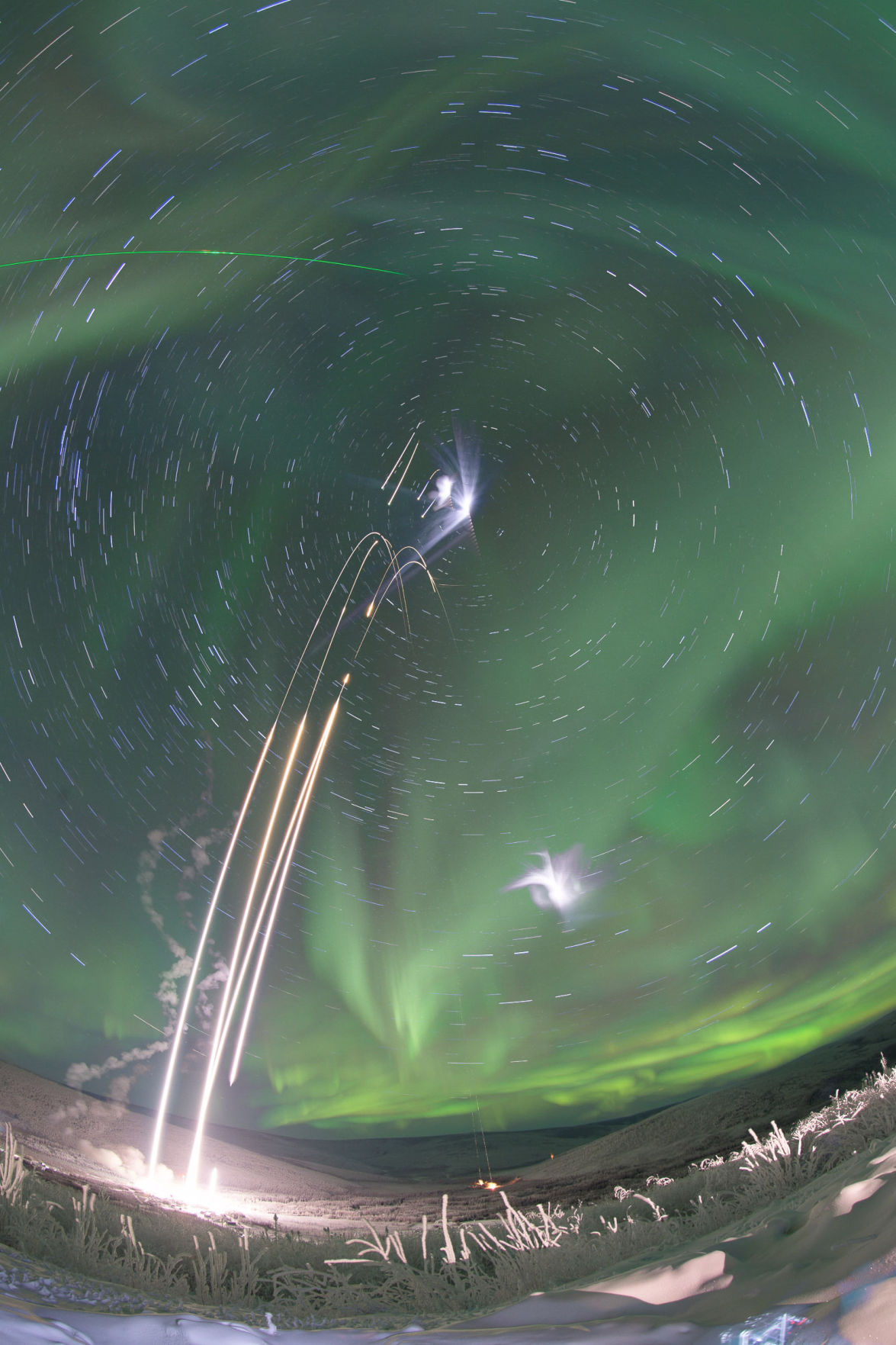 Composite image of four rockets launched