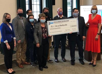 $600,000 check presentation photo