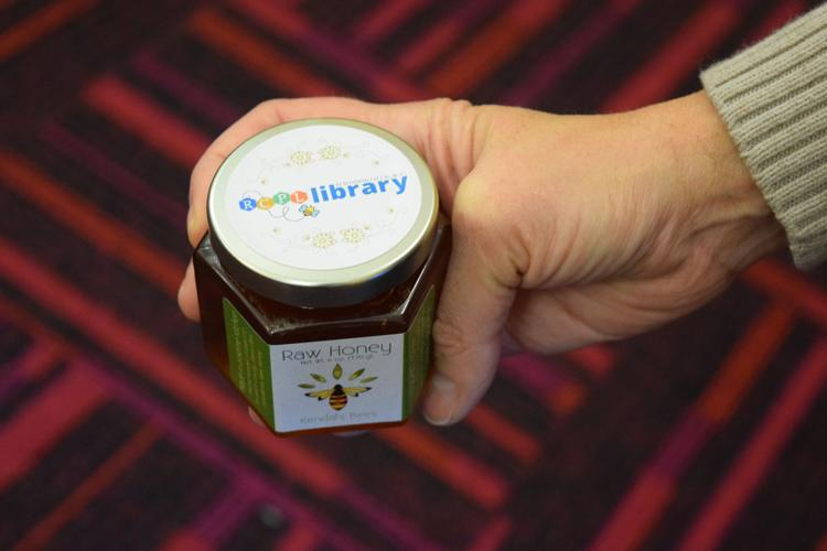 A jar of honey produced by the library's bees that was harvested in September. The library's hives only produced 40 pounds of honey last year, but could produce as much as 300 pounds if the bees have a productive year.  Zachary Clark/Daily Journal