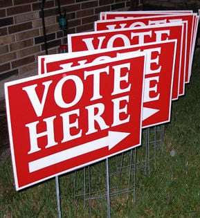 vote here signs logo