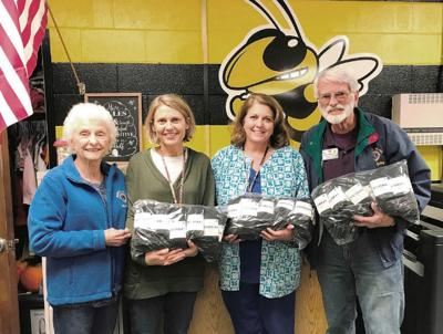 Moneta Lions donate socks to students