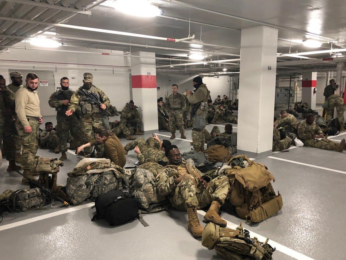 U.S. National Guard soldiers moved to parking garage