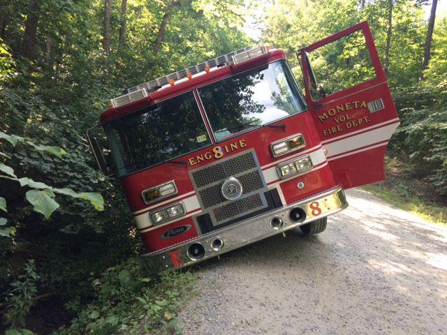 Moneta fire truck wrecks to avoid colliding with pickup
