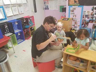 Emergency dispatcher reads to local kids