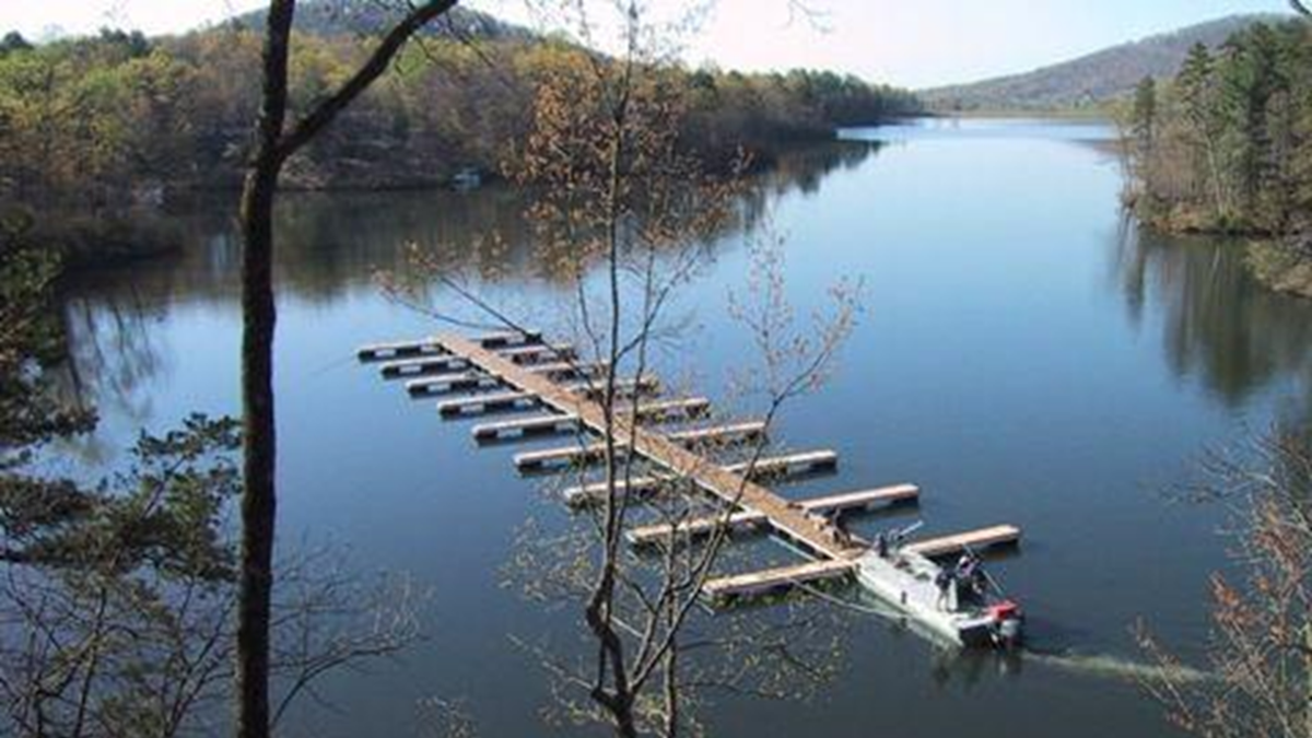 Moving docks from one end of the lake to the other is often challenging.