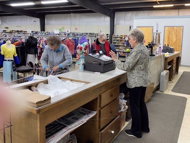 Jo Young working the register at the Thrift Store in Jasper.