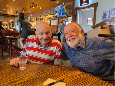 John D'Antonio (left) and Bob Anderson share a beer at a restaurant in Decatur.