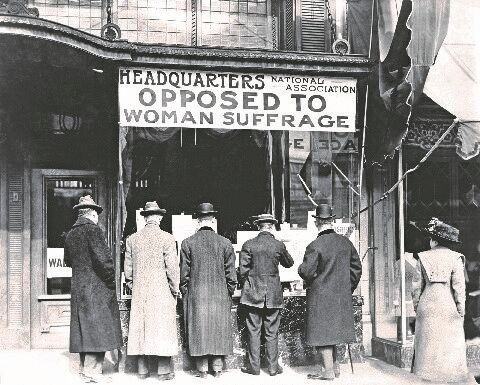 Men look in the window of the National Anti-Suffrage Association headquarters, which was active at the state and national levels. Many women opposed suffrage as well. (ca. 1911)