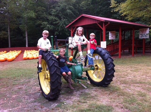 From left, Big Canoe neighbors Jack Lowrie, Olivia Hickman, Miranda Lowrie and Banks Hickman visit Burt's Pumpkin Farm in 2011.