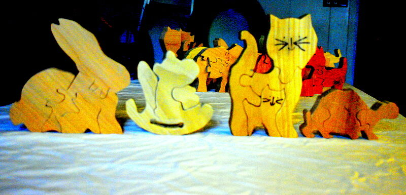 Santa's woodworking helpers are busy making puzzles for needy children