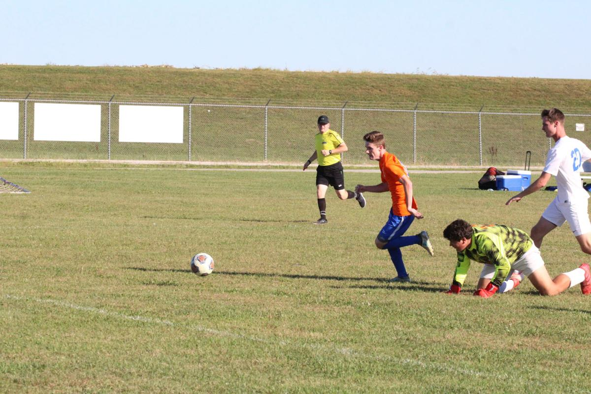 26-t-c soccer seth tavernor gets by goalie and scores.jpg