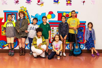 ProjectArt students in the performance at Homestead Library enjoyed preparing for their show. Left to right: J.P. Gonzalez, Kayla Lovllette, Sebastian Maldonado, Aidan Rosa, Emma Bruera, Jose Gonzalez, Charlotte Torres. Resident Artist Sonia Baez Hernandez is in front with Giselle Galarca.