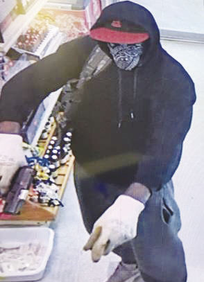 Security camera picture of suspect from scene of Krome Avenue armed robbery on Friday, Oct. 20.