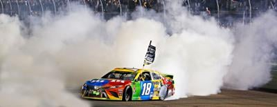 Kyle Busch celebrating his championship win at Homestead-Miami Speedway in 2019.