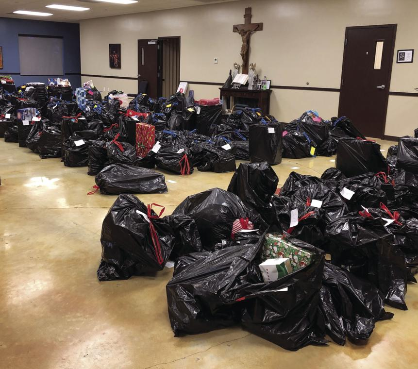 The hall at Sacred Heart is filled with sacks of gifts for area children.