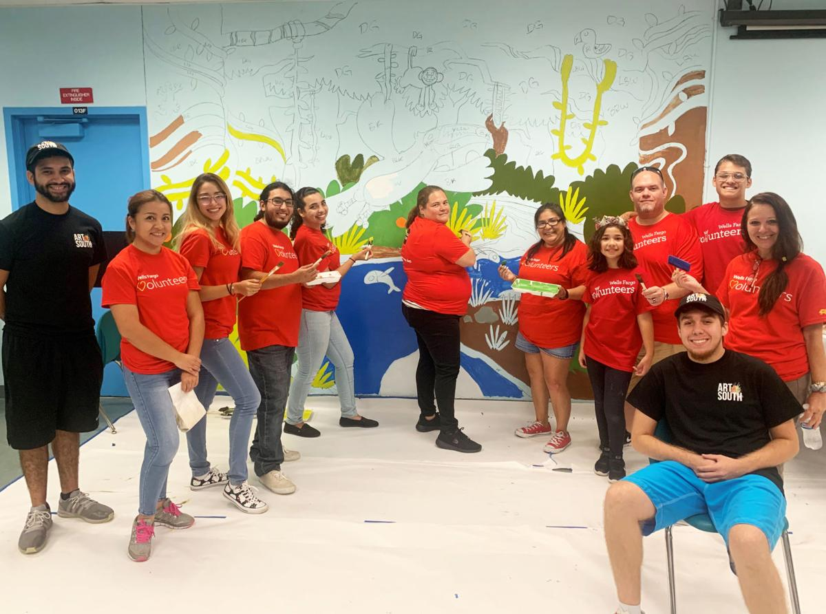 Wells Fargo employees volunteer for a day of service to  beautify the Neva King Cooper School in Homestead.   This mural is just one example of their work.