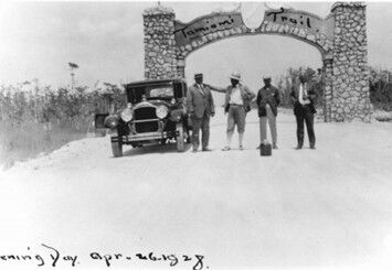 The archway between Dade and Collier Counties on April 26, 1928, the day the Tamiami Trail officially opened. Completing this roadway was crucial for the development of southwestern Florida, but it had disastrous effects on the ecosystem by blocking water flow to the Everglades. Photo: Collier County Museum