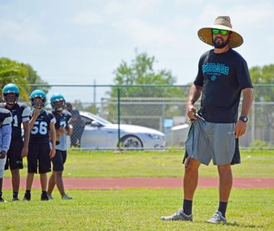 Coral Reef head coach Joseph Petisco with his players.